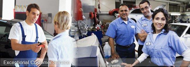 people providing customer service in a mechanic shop.