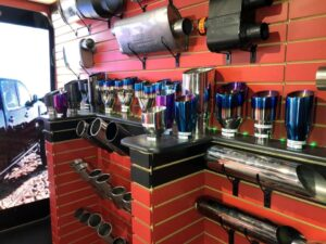 colourful assortment of exhaust tips in edmonton auto repair shop, sherwood park